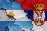 flags of Argentina and Serbia painted on cracked wall
