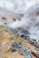 Mountain landscape, crater of active volcano: fumarole, hot spring, lava field, gas-steam activity. Dramatic volcanic landscape, travel destinations