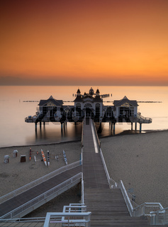 vertical view of the Sellin Pier on the Baltic Sea at sunrise