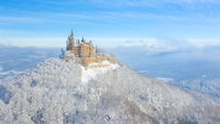 Aerial view of the Castle Hohenzollern in Germany by snowy winter