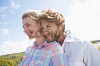 Smiling couple standing outside together
