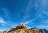 Autumn alpine Dolomites rocky  mountain scene, Sudtirol, Italy. Peaceful view near Sella Pass.
