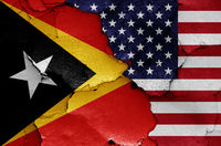 flags of East Timor and USA painted on cracked wall
