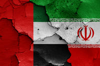 flags of UAE and Iran painted on cracked wall