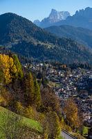 Autumn Dolomites village Falcade, Italy