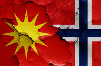 flags of Bodo and Norway painted on cracked wall