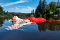 Pregnant woman floating in a lake