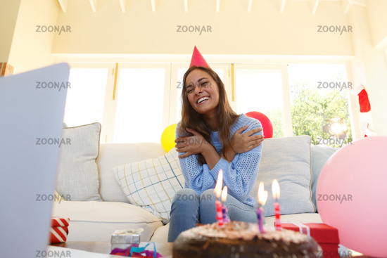 Caucasian woman having birthday video call wearing party hat