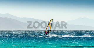windsurfer rides on a background of high mountains in Egypt Dahab South Sinai