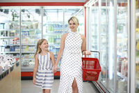 Young woman with daughter in supermarket