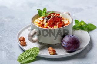 Millet porridge with caramelized plum for a healthy breakfast.