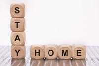 Stay home written on wooden cubes