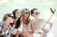Girls with smartphone taking selfie
