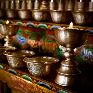 Burning oil lamps at Buddhist monastery