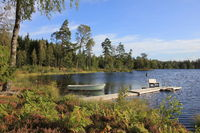 Idyllic place near Backefors, Sweden. Small lake surrounded by forest.