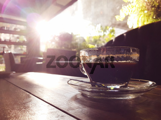 Hot black coffee on wooden tablet at coffee shop