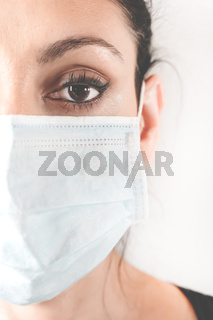 Medical mask on woman face