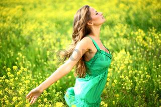 Woman on oilseed field