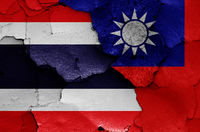 flags of Thailand and Taiwan painted on cracked wall