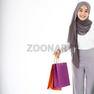 Muslim girl shopping bags closeup