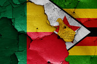 flags of Benin and Zimbabwe painted on cracked wall