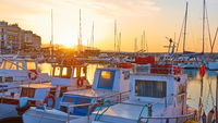 Fishing boats in the port of Heraklion at sunset