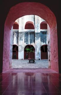 Patio with wooden seat in the former monestary Convent de San Bernardino de Siena in Valladolid, Yucatan, Mexico