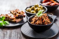 Tapenade - delicious olive paste from France with ingredients and crostini.