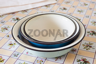 Old enamel dishes on a table