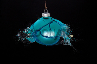 A shattering bauble. Concept for a christmas ruined by an argument