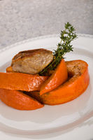 Grilled duck breast with pumpkin and fresh thyme.
