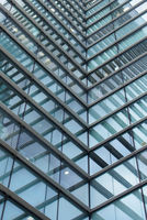 a full frame modern office architecture abstract with geometric angular reflected shapes and lines in blue glass windows