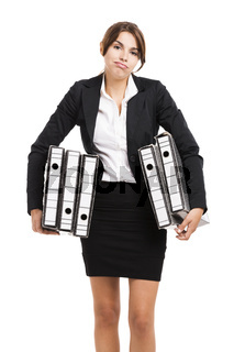 Business woman carying folders