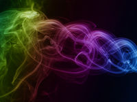 Abstract rainbow colored smoke on black