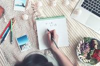 Crop woman creating wish list
