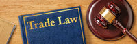 A gavel with a law book - Trade Law