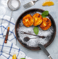 Cottage cheese fritters with vanilla and orange zest.