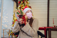 Girl holding a Christmas present on New Years Eve.