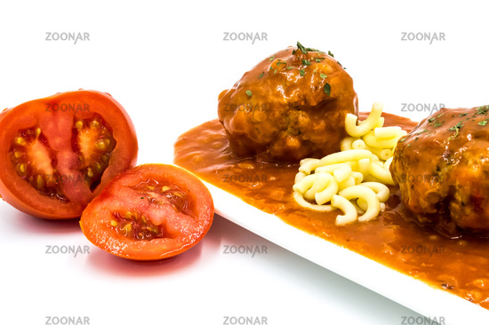 Meatballs cooked in tomato sauce with small pasta