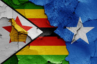 flags of Zimbabwe and Somalia painted on cracked wall