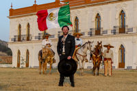 A Very Handsome Mexican Charro Poses In Front Of A Hacienda In The Mexican Countryside