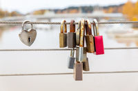 Padlocks hang on bridge as symbol of love