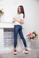 Lovely brunette dressed in jeans