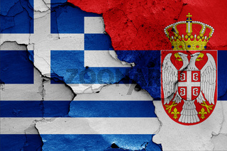 flags of Greece and Serbia painted on cracked wall
