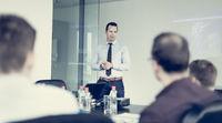 Team leader making presentation on corporate business meeting.