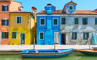 Colorful houses by canal in Burano in Venice