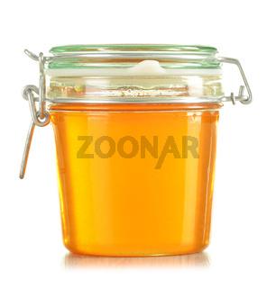 Jars of honey isolated on white