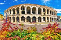 Roman amphitheatre Arena di Verona and Piazza Bra square autumn leaves view