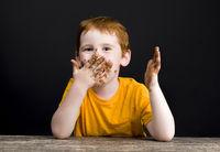 boy smeared in milk chocolate