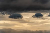 Beautiful dramatic thunderstorm clouds in sky during rain. Dramatic natural cloudiness weather background